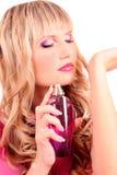 mujer con la botella de perfume Fotografía de archivo libre de regalías