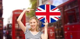 Mujer con la burbuja del texto de la bandera británica en Londres Imágenes de archivo libres de regalías