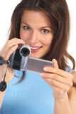 Mujer con la cámara de vídeo Imágenes de archivo libres de regalías