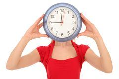 Mujer con la cara de la cubierta del reloj Foto de archivo libre de regalías