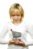 Mujer con la carretilla de las compras Imagen de archivo