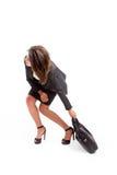 Mujer con la cartera pesada Foto de archivo libre de regalías