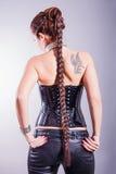 Mujer con la cola negra larga Fotos de archivo