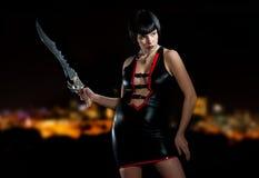 Mujer con la espada foto de archivo libre de regalías