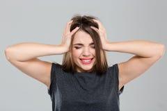Mujer con la expresión deprimida Imagen de archivo libre de regalías