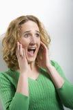 Mujer con la expresión facial sorprendida Fotos de archivo libres de regalías