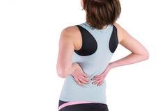Mujer con la lesión dorsal Fotos de archivo libres de regalías