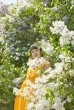 Mujer con la lila Imagen de archivo libre de regalías