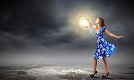 Mujer con la linterna Imagenes de archivo