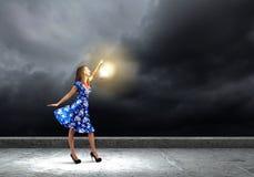 Mujer con la linterna Fotos de archivo