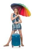 Mujer con la maleta y el paraguas aislados Imagenes de archivo