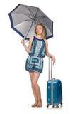 Mujer con la maleta y el paraguas aislados Foto de archivo libre de regalías
