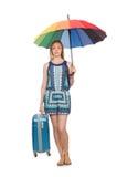 Mujer con la maleta y el paraguas aislados Fotografía de archivo
