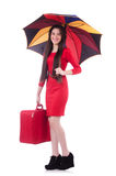 Mujer con la maleta y el paraguas aislados Fotos de archivo libres de regalías