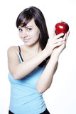 Mujer con la manzana roja Fotos de archivo