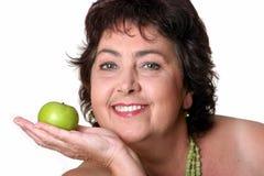 Mujer con la manzana verde Imagen de archivo