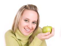 Mujer con la manzana verde Fotografía de archivo