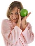 Mujer con la manzana verde Foto de archivo