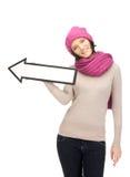 Mujer con la muestra de la flecha de la dirección Foto de archivo