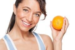 Mujer con la naranja Fotografía de archivo libre de regalías