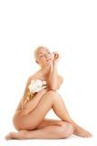 Mujer con la orquídea blanca Imágenes de archivo libres de regalías