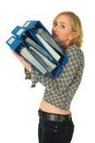 Mujer con la pila de carpetas Imágenes de archivo libres de regalías