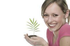 Mujer con la planta creciente Imágenes de archivo libres de regalías