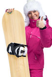 Mujer con la snowboard que da los pulgares para arriba Fotografía de archivo
