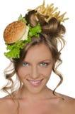 Mujer con la sonrisa de la hamburguesa y de las fritadas Fotos de archivo