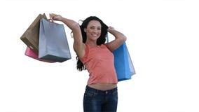 Mujer con la sonrisa de los bolsos de compras Foto de archivo libre de regalías