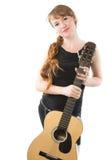 Mujer con la trenza y la guitarra largas Imagen de archivo