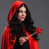 Mujer con la vara mágica Imagenes de archivo
