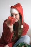 Mujer con la vela de la Navidad Imagen de archivo