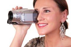 Mujer con la videocámara Fotos de archivo