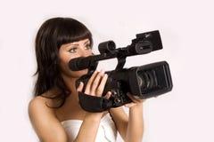 Mujer con la videocámara Foto de archivo libre de regalías