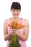 Mujer con la zanahoria imagenes de archivo