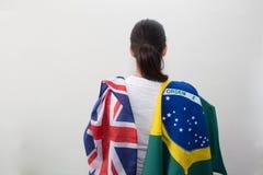 Mujer con las banderas en el fondo blanco Imágenes de archivo libres de regalías