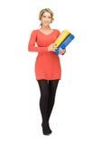 Mujer con las carpetas Imagen de archivo libre de regalías