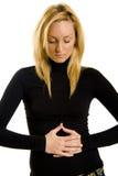 Mujer con las ediciones del estómago Foto de archivo libre de regalías