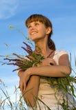 Mujer con las flores foto de archivo libre de regalías