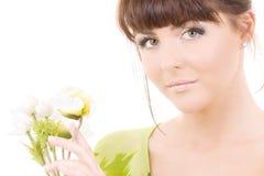 Mujer con las flores imagen de archivo libre de regalías