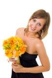Mujer con las flores del otoño Imagen de archivo