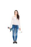 Mujer con las herramientas aisladas en blanco Fotografía de archivo libre de regalías