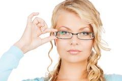 Mujer con las lentes Imagenes de archivo