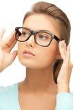 Mujer con las lentes Fotos de archivo