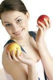 Mujer con las manzanas Fotos de archivo libres de regalías