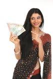 Mujer con las notas del dinero en circulación fotos de archivo