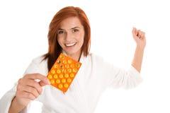 Mujer con las píldoras Foto de archivo libre de regalías