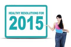 Mujer con las resoluciones sanas para 2015 Foto de archivo