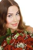 Mujer con las rosas Fotos de archivo